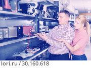 Купить «Couple buying coffee machine in household appliances store», фото № 30160618, снято 1 марта 2018 г. (c) Яков Филимонов / Фотобанк Лори