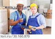 Купить «Contractors discussing building works», фото № 30160870, снято 4 мая 2018 г. (c) Яков Филимонов / Фотобанк Лори