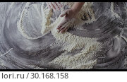 Купить «The cook's hands in a fresh flour are moving powder in a pile on a wooden table . Slow motion, Full HD video, 240fps, 1080p. Process preparing of homemade pastry. Top view.», видеоролик № 30168158, снято 31 августа 2018 г. (c) Ярослав Данильченко / Фотобанк Лори