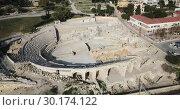 Купить «Aerial view of ruins of ancient Roman amphitheater in Spanish city of Tarragona», видеоролик № 30174122, снято 17 января 2019 г. (c) Яков Филимонов / Фотобанк Лори