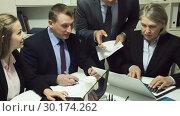 Купить «Serious business people working at office», видеоролик № 30174262, снято 12 февраля 2019 г. (c) Яков Филимонов / Фотобанк Лори
