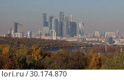 Купить «View of the city and the complex of skyscrapers Moscow city from Sparrow Hills or Vorobyovy Gory observation (viewing) platform-- is on a steep bank 85 m above the Moskva river, or 200 m above sea level. Moscow, Russia», видеоролик № 30174870, снято 23 февраля 2019 г. (c) Владимир Журавлев / Фотобанк Лори