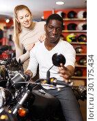 Купить «couple in motorcycle shop choosing new vehicle», фото № 30175434, снято 16 января 2019 г. (c) Яков Филимонов / Фотобанк Лори