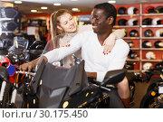 Купить «couple choosing motorcycle accessories and riding gear», фото № 30175450, снято 16 января 2019 г. (c) Яков Филимонов / Фотобанк Лори