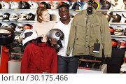 Купить «Couple holding purchased riding gear», фото № 30175466, снято 16 января 2019 г. (c) Яков Филимонов / Фотобанк Лори