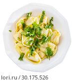 Купить «Top view of ravioli with greens», фото № 30175526, снято 25 марта 2019 г. (c) Яков Филимонов / Фотобанк Лори