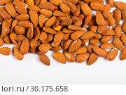 Купить «Close up of roasted almonds on white surface, no people», фото № 30175658, снято 17 июля 2019 г. (c) Яков Филимонов / Фотобанк Лори