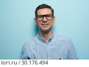 Купить «Young handsome guy office manager», фото № 30176494, снято 13 декабря 2018 г. (c) Pavel Biryukov / Фотобанк Лори
