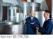 Купить «Two male employees at winery», фото № 30176726, снято 20 февраля 2020 г. (c) Яков Филимонов / Фотобанк Лори