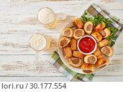 Купить «sausage rolls with tomato sauce and beer», фото № 30177554, снято 19 февраля 2019 г. (c) Oksana Zh / Фотобанк Лори