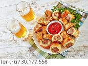 Купить «freshly baked Puff pastry Sausage rolls, top view», фото № 30177558, снято 19 февраля 2019 г. (c) Oksana Zh / Фотобанк Лори