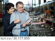 Купить «Mature man and woman at traditional flea market», фото № 30177850, снято 23 октября 2017 г. (c) Яков Филимонов / Фотобанк Лори