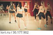Купить «Young slender women performing modern dance in fitness studio», фото № 30177902, снято 31 мая 2017 г. (c) Яков Филимонов / Фотобанк Лори