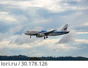 Купить «Bangkok Air flying over the mountains», фото № 30178126, снято 26 ноября 2016 г. (c) Игорь Жоров / Фотобанк Лори