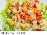 Купить «Caesar salad with grilled chicken on a white plate», фото № 30178646, снято 19 июля 2019 г. (c) Яков Филимонов / Фотобанк Лори