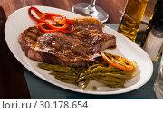 Купить «Entrecote with asparagus and orange», фото № 30178654, снято 20 июля 2019 г. (c) Яков Филимонов / Фотобанк Лори
