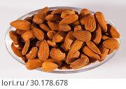 Купить «Image of roasted salt almonds on glass bowl, nobody», фото № 30178678, снято 17 июля 2019 г. (c) Яков Филимонов / Фотобанк Лори