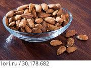 Купить «Roasted almonds on wooden table», фото № 30178682, снято 29 февраля 2020 г. (c) Яков Филимонов / Фотобанк Лори