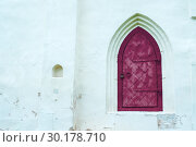 Купить «Architecture view of architecture elements- aged dark blue metal forged door with arcade on the white stone wall», фото № 30178710, снято 19 августа 2016 г. (c) Зезелина Марина / Фотобанк Лори