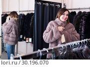 Купить «Adult girl deciding on the choice of fur coat», фото № 30196070, снято 26 марта 2019 г. (c) Яков Филимонов / Фотобанк Лори
