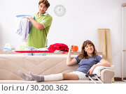 Купить «Husband helping leg injured wife in housework», фото № 30200362, снято 4 октября 2018 г. (c) Elnur / Фотобанк Лори