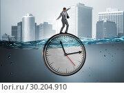 Купить «Businessman in deadline and time management concept», фото № 30204910, снято 19 марта 2019 г. (c) Elnur / Фотобанк Лори