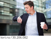Купить «Portrait of busy man rushing to important meeting», фото № 30206082, снято 20 апреля 2017 г. (c) Яков Филимонов / Фотобанк Лори