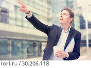 Купить «Male pointing finger at object», фото № 30206118, снято 20 апреля 2017 г. (c) Яков Филимонов / Фотобанк Лори