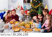 Купить «Large family eating together during festive Christmas dinner», фото № 30206238, снято 16 июня 2019 г. (c) Яков Филимонов / Фотобанк Лори