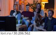Купить «friends with drinks and snacks watching tv at home», видеоролик № 30206562, снято 12 января 2019 г. (c) Syda Productions / Фотобанк Лори