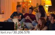 Купить «happy friends taking selfie by smartphone at home», видеоролик № 30206578, снято 12 января 2019 г. (c) Syda Productions / Фотобанк Лори
