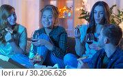 Купить «friends eating pizza and drinking wine at home», видеоролик № 30206626, снято 12 января 2019 г. (c) Syda Productions / Фотобанк Лори