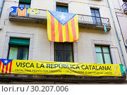 Купить «Catalonia Independence Flags on balconies. The Catalan independence movement is a political movement historically derived from Catalan nationalism», фото № 30207006, снято 23 января 2019 г. (c) Papoyan Irina / Фотобанк Лори