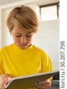 Купить «Front view of boy using digital tablet in a classroom», фото № 30207798, снято 10 ноября 2018 г. (c) Wavebreak Media / Фотобанк Лори