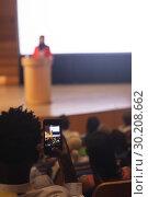 Купить « Man with smartphone taking video clip of businesswoman in the auditorium », фото № 30208662, снято 15 ноября 2018 г. (c) Wavebreak Media / Фотобанк Лори