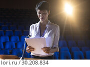 Купить «Businesswoman standing at podium on stage in auditorium», фото № 30208834, снято 15 ноября 2018 г. (c) Wavebreak Media / Фотобанк Лори