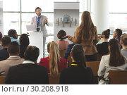 Купить «Businesswoman interacting with male speaker in a business seminar», фото № 30208918, снято 21 ноября 2018 г. (c) Wavebreak Media / Фотобанк Лори