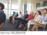 Купить «Business people attending a business seminar», фото № 30209018, снято 21 ноября 2018 г. (c) Wavebreak Media / Фотобанк Лори