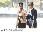 Купить «Business people interacting with each other in lobby», фото № 30209254, снято 21 ноября 2018 г. (c) Wavebreak Media / Фотобанк Лори