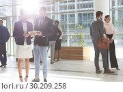 Купить «Diverse business people looking and discussing over digital tablet in lobby office », фото № 30209258, снято 21 ноября 2018 г. (c) Wavebreak Media / Фотобанк Лори