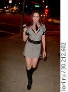 Купить «Playboy TV host Erika Jordan dressed as a sexy corrections officer as she leaves a pre-Halloween party in Los Angeles, California. Featuring: Erika Jordan...», фото № 30212602, снято 30 октября 2017 г. (c) age Fotostock / Фотобанк Лори