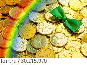 Купить «St Patrick's Day background. Golden coins with shamrock, green bow tie and rainbow, St Patrick's day symbols», фото № 30215970, снято 13 февраля 2019 г. (c) Зезелина Марина / Фотобанк Лори