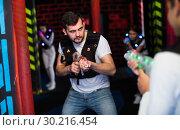 Купить «Excited guy during lasertag game», фото № 30216454, снято 25 апреля 2018 г. (c) Яков Филимонов / Фотобанк Лори