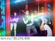 Купить «Excited guy laser tag player in bright beams», фото № 30216458, снято 25 апреля 2018 г. (c) Яков Филимонов / Фотобанк Лори