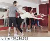 Купить «Young adults dancing in a studio», фото № 30216558, снято 19 апреля 2019 г. (c) Яков Филимонов / Фотобанк Лори