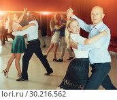 Купить «Couples enjoying foxtrot», фото № 30216562, снято 4 октября 2018 г. (c) Яков Филимонов / Фотобанк Лори