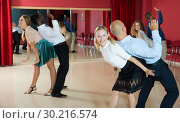 Купить «Glad smiling people practicing lindy hop technique in dance class», фото № 30216574, снято 4 октября 2018 г. (c) Яков Филимонов / Фотобанк Лори