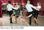 Купить «People practicing vigorous jive movements together at modern dance studio», фото № 30216590, снято 4 октября 2018 г. (c) Яков Филимонов / Фотобанк Лори
