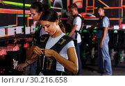 Купить «people looking laser guns and clothes together», фото № 30216658, снято 23 августа 2018 г. (c) Яков Филимонов / Фотобанк Лори