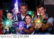 Купить «Young friends posing with colored laser guns in dark labyrinth», фото № 30216686, снято 23 августа 2018 г. (c) Яков Филимонов / Фотобанк Лори